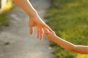 Taking the hand of a child